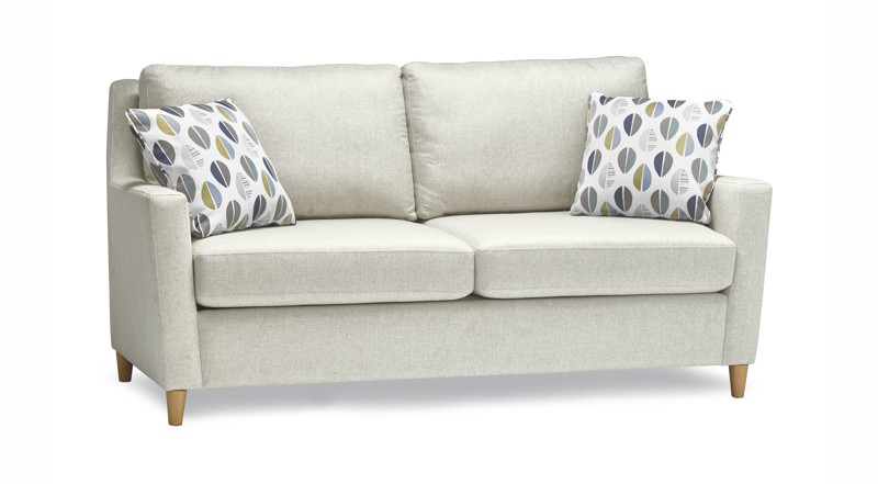 Beige 2 seat stylus sofa with pillows.