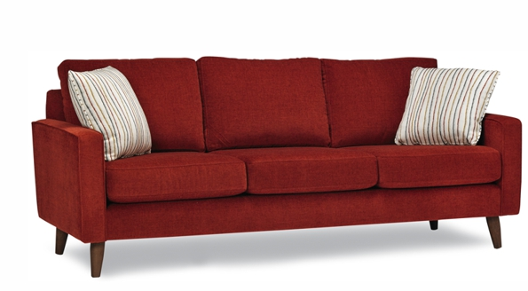 Red Adel Stylus Sofa with beige pillows and solid wood legs.