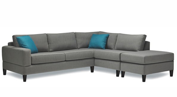 8 seat Cali Stylus Sofa with blue pillows.