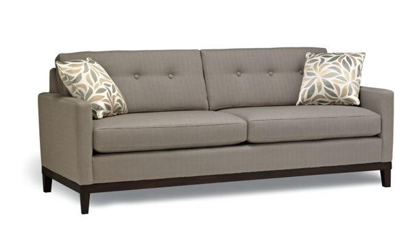 Grey Capri Stylus Sofa with wood legs.