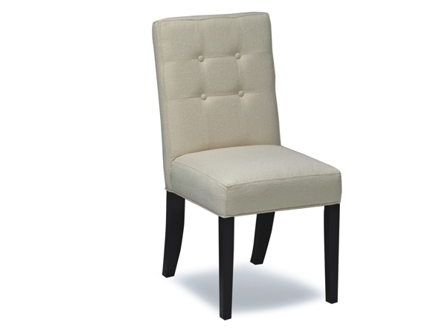White tall dining chair with long wood legs without arms