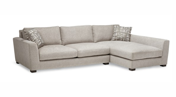 A long beige sofa with three seats and one extra long laydown design