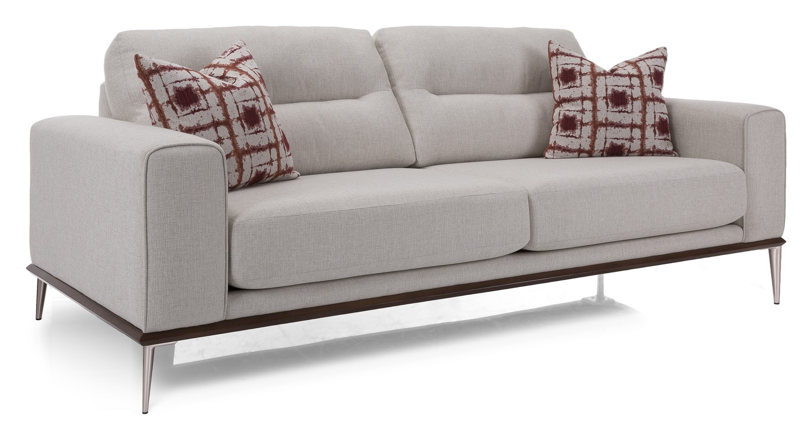 modern two seat sofa with silver legs and two red pillows