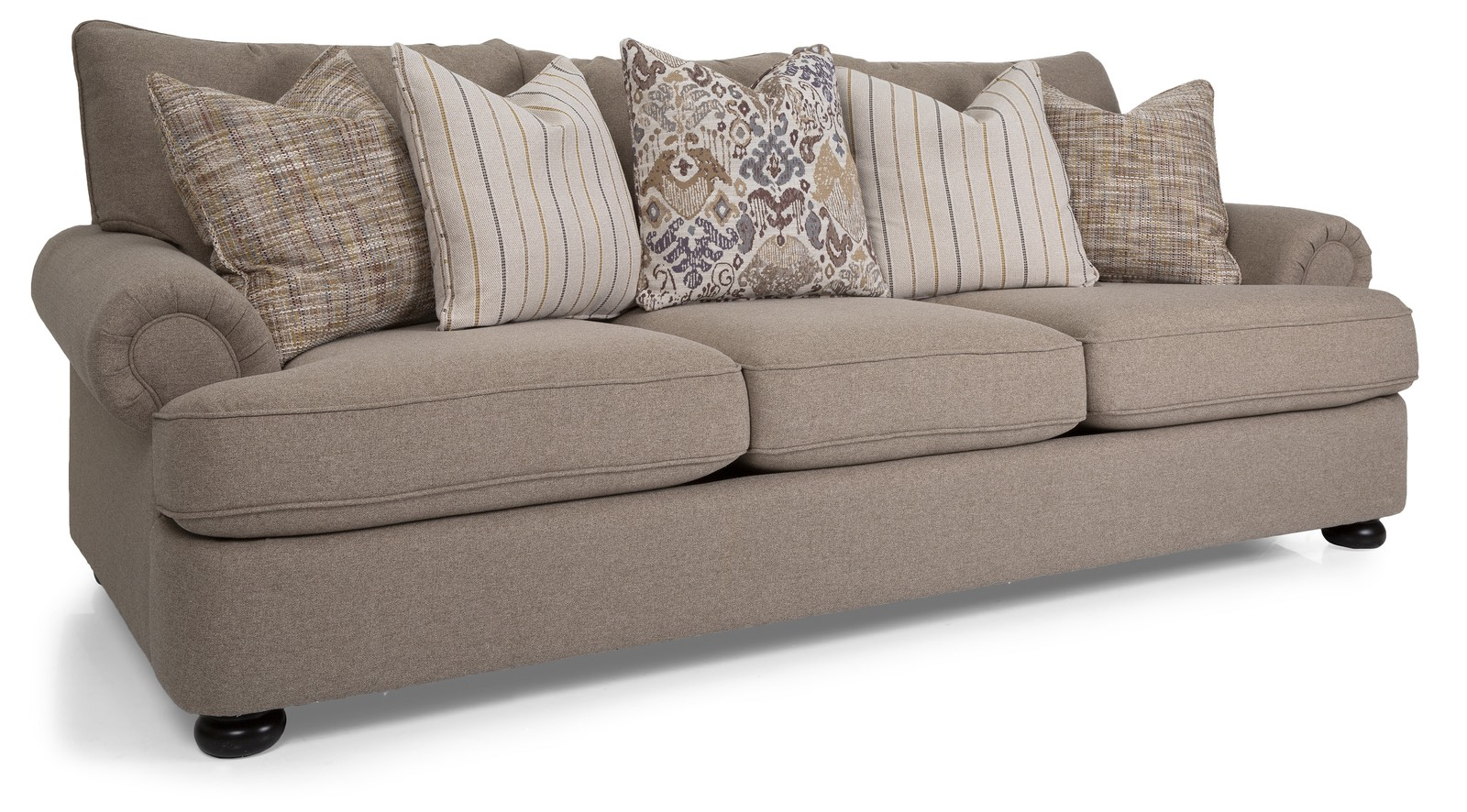 three seat beige sofa with five pillows