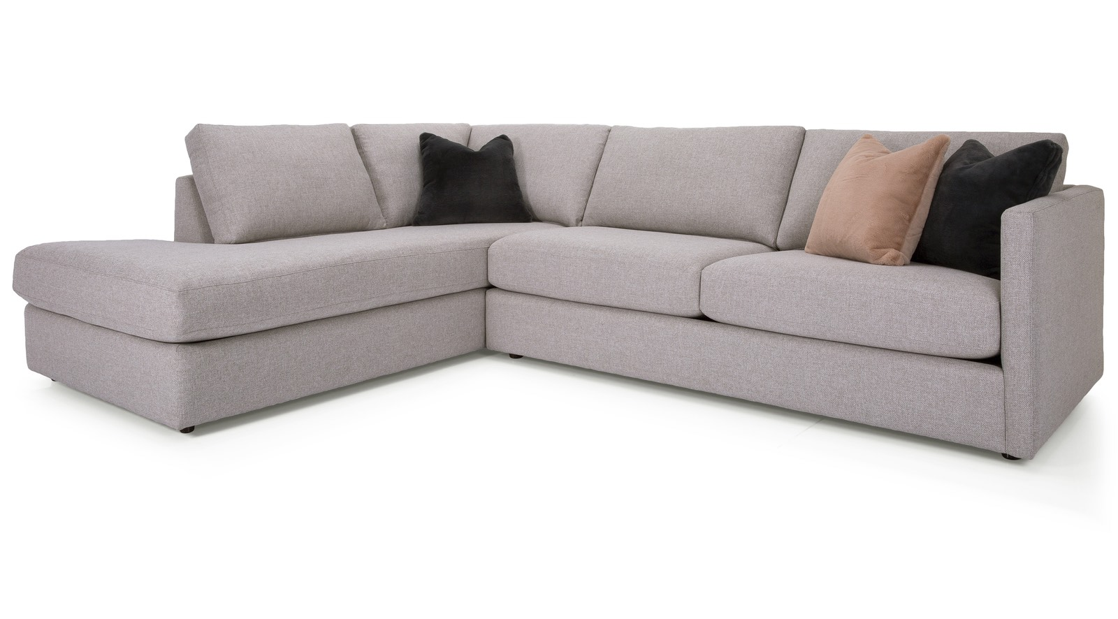 A modern L shaped sectional sofa with two black pillows